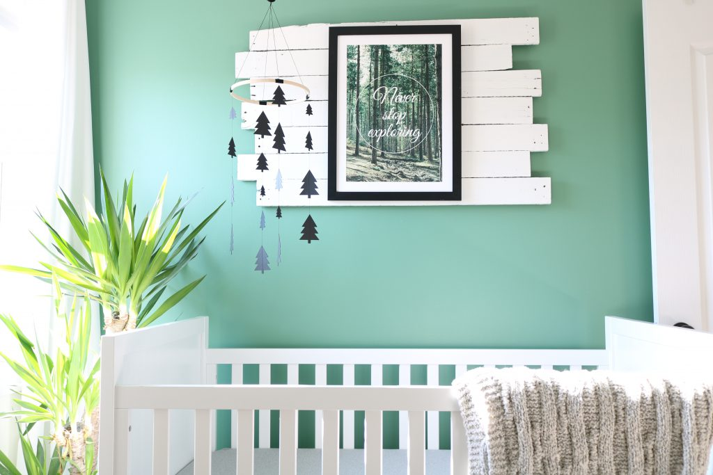 Bright green children's room with crib in it